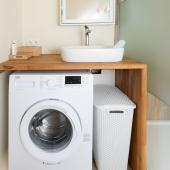 Een wasmachine is aanwezig