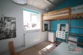 Slaapkamer met hoogslaper
