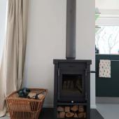 The wood stove provides atmosphere and warmth